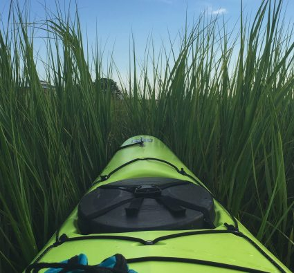 kayak going through the marsh on kiawah island