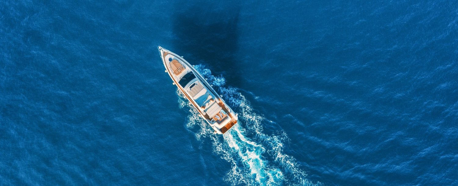 Arial view of boat sailing in in the blue waters of the bohicket marina