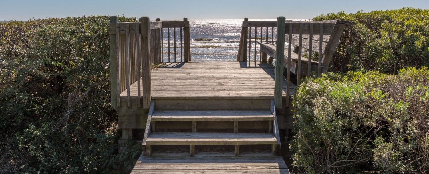 View of private wooden pathway to beach