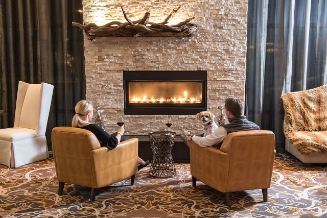 Couple sitting by fire place in Great Room