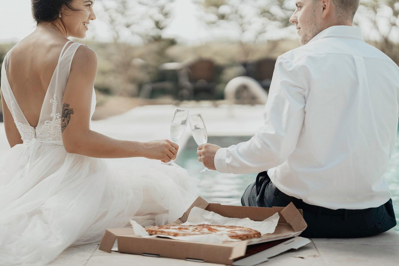 Bride & Groom eating pizza